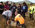 Joe Waikari from DOC shows students from Pourewa Class at Tolaga Bay Area School & Kahukuranui how to set up predator traps around Kaitawa Estuary